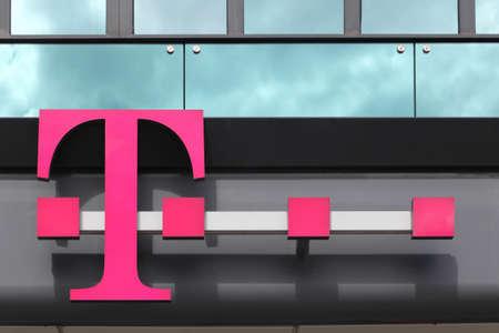 Berlin, Germany - July 12, 2020: Deutsche Telekom logo on a building. Deutsche Telekom is a German telecommunications company headquartered in Bonn Redactioneel
