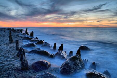 Old Groyne on the beach of the Baltic Sea.