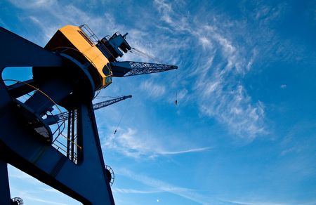 Port crane in the city harbor of Rostock. Stock Photo - 6483436
