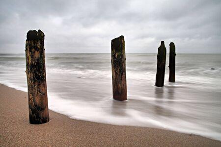 groyne: Groyne on the beach of the Baltic Sea. Stock Photo