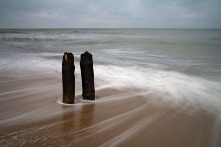 Groyne on the beach of the Baltic Sea. Stock Photo