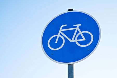 A blue signpost witch allowed bicycles. Stock Photo