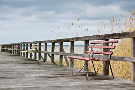 Benches on a pier. Stok Fotoğraf