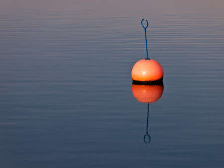 Buoy in the city port of Rostock (Germany). Stock Photo