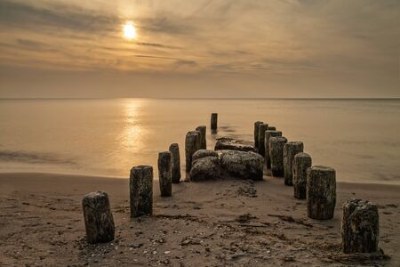 Sunset on shore of the Baltic Sea  photo