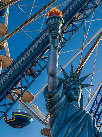 A statue in front of a ferris wheel  Stock Photo - 14398019