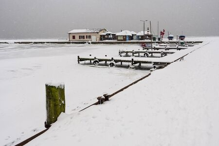 Port on shore of the Baltic Sea in winter  photo