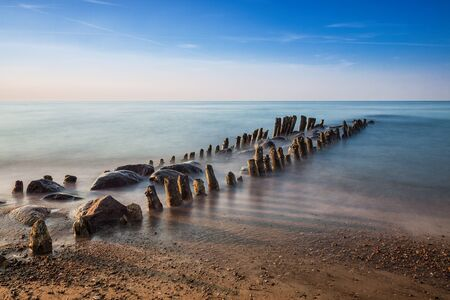 Groynes on shore of the Baltic Sea