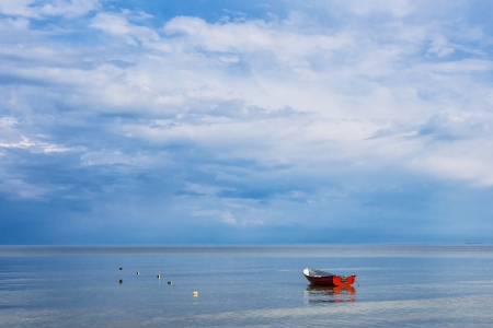 Boat on shore of the Baltic Sea  photo