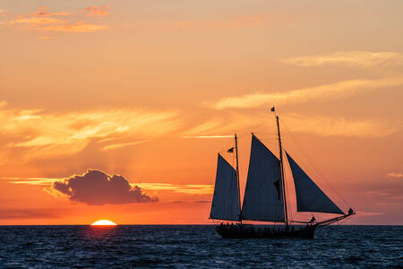 Windjammer and sunset on the Baltic Sea  photo