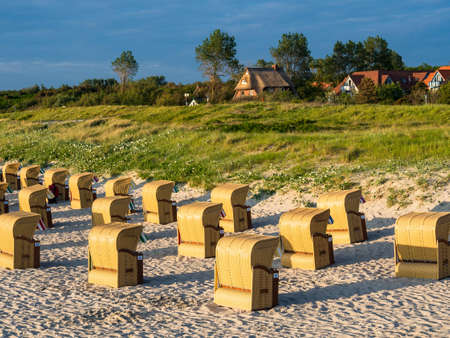 beach chairs: Beach chairs on shore of the Baltic Sea in Wustrow (Germany).