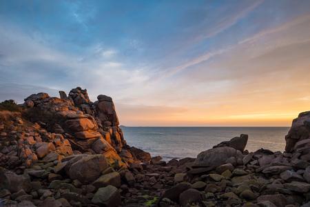 sunup: Atlantic ocean coast in Brittany near Ploumanach France.
