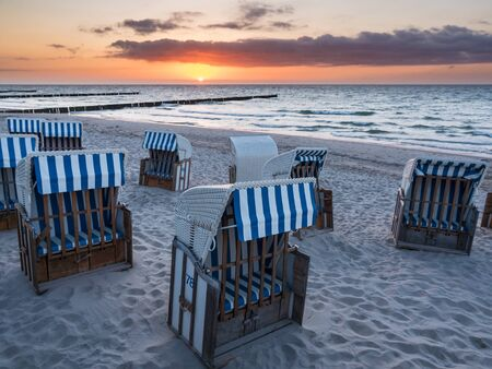 mecklenburg  western pomerania: Beach chairs on the Baltic Sea coast with sunset. Stock Photo