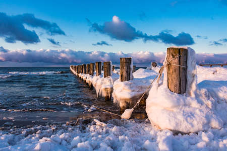 groyne: Groyne on shore of the Baltic Sea in winter. Stock Photo