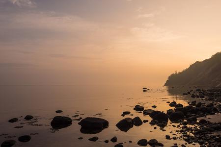 sunup: Sunrise on shore of the Baltic Sea.
