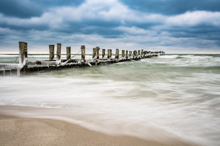 groyne: Groyne on the Baltic Sea coast in Zingst (Germany). Stock Photo