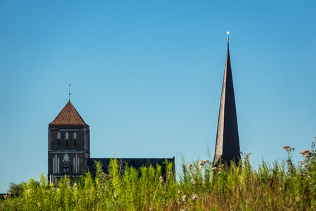 Churches in Rostock (Germany) with blue sky.