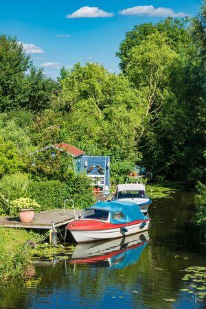 Boatshouse on the river Warnow in Rostock (Germany). Stock Photo