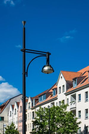 Buildings with lantern in Rostock (Germany) with blue sky. Stock Photo