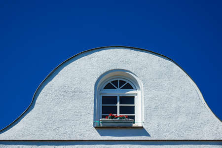 Building with a window and blue sky. Stock Photo