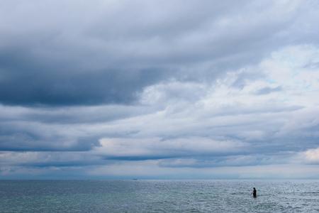 Angler on shore of the Baltic Sea.