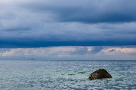 Stone on shore of the Baltic Sea. Stock Photo