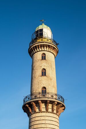 The lighthouse on the beach in Warnemuende, Germany.