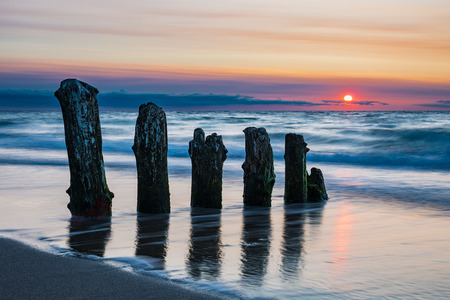 Groynes on shore of the Baltic Sea in Kuehlungsborn, Germany.