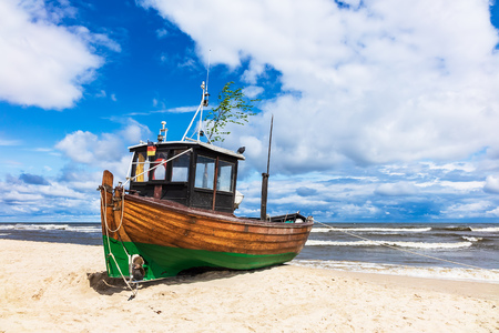 Fishing boat on shore of the Baltic Sea in Ahlbeck, Germany.