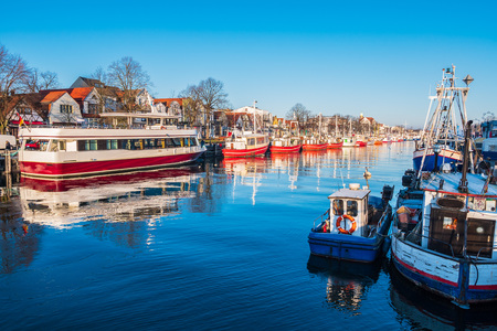 Fishing boats in winter time in Warnemuende, Germany. Editorial