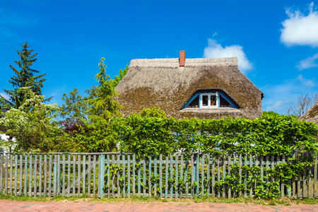 Old building with thatched roof in Wieck, Germany. Zdjęcie Seryjne