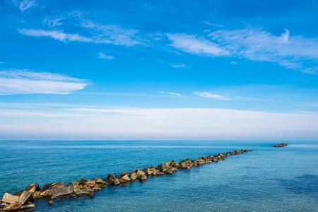 Baltic Sea coast with blue sky in Wustrow, Germany. 免版税图像