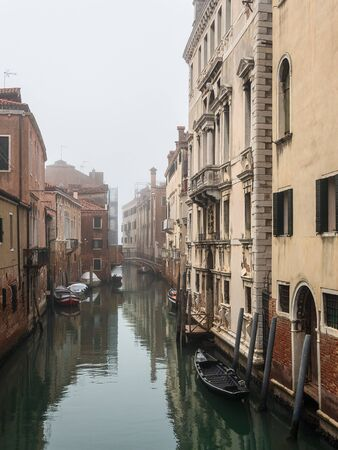 Historical buildings and channel in the city Venice, Italy.