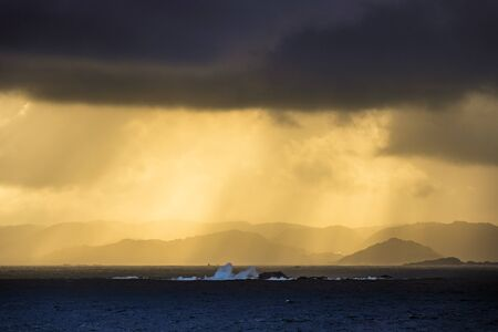 View to the Lyngdalsfjord with sunset in Norway.