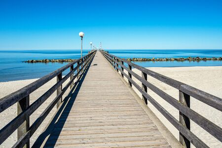 Pier on the Baltic Sea coast in Wustrow, Germany.
