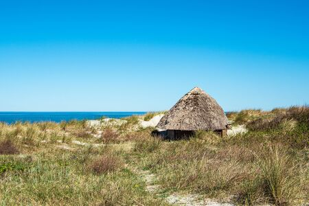 Beach cottage on the Baltic Sea coast in Wustrow, Germany. Stock Photo
