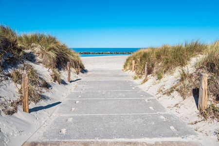Way to the beach on the Baltic Sea coast in Wustrow, Germany.