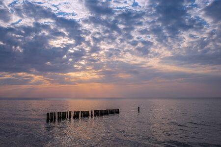 Groynes on shore of the Baltic Sea in Graal Mueritz, Germany. Stock Photo