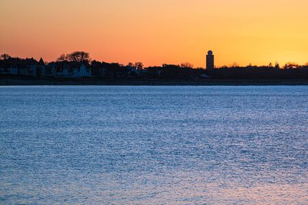 Sunset on shore of the Baltic Sea in Warnemuende, Germany. Stock Photo