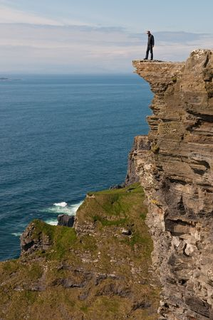 Man on a cliff Stock Photo