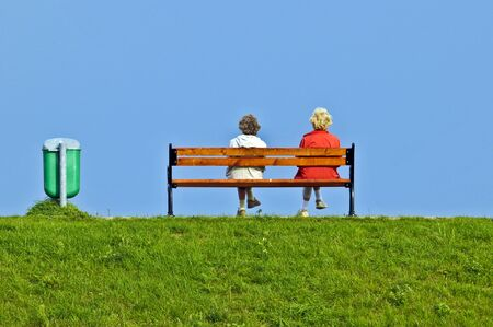 Two elder woman on a bench Stock Photo