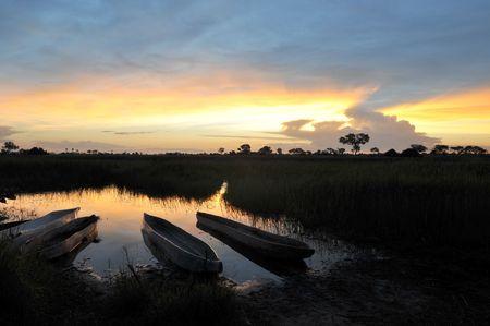 Okavango Delta with Mokoros at sunset