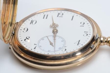A golden pocket watch Stock Photo