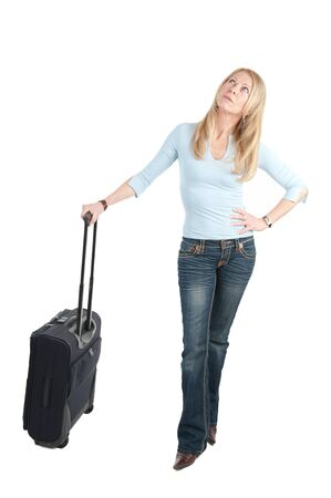 tardiness: Middle aged woman with wheely bag on white background Stock Photo