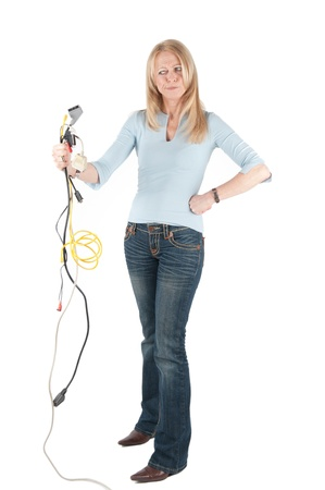 bedlam: Middle aged woman with cables and plugs on isolated background Stock Photo