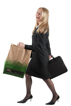 Middle aged Business woman with briefcase and carrier bag, cut out photo