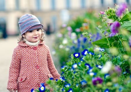 Adorable girl with flowers