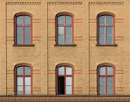 Front of a brick row house with 6 windows