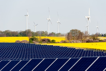 Wind turbines and solar panels in a rapeseed field Stock Photo - 13530925