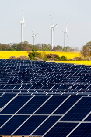 Wind turbines and solar panels in a rapeseed field Stock Photo - 13530924
